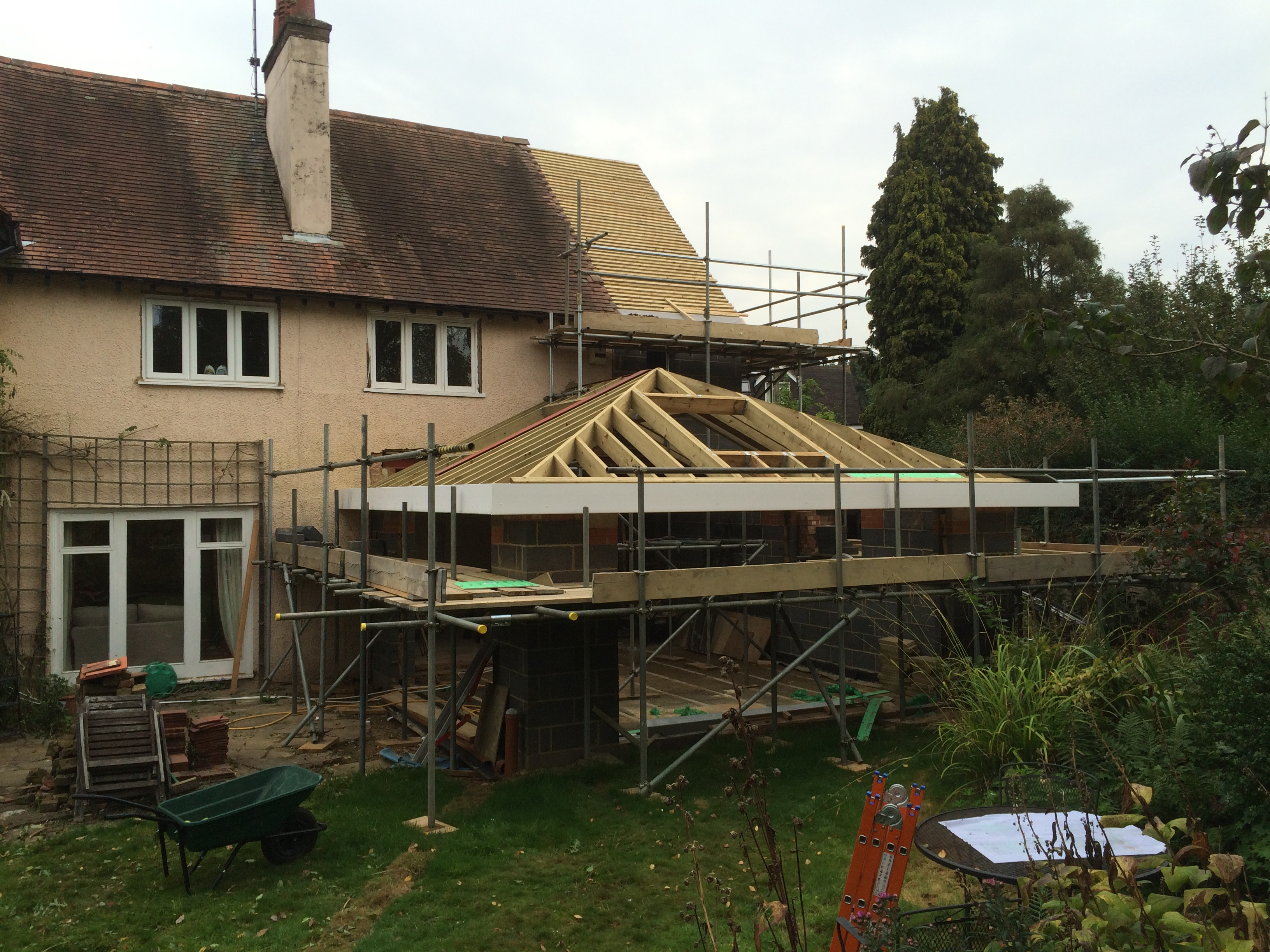 Side extension and rear extension roof